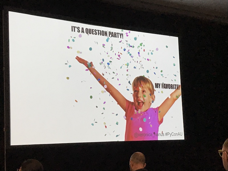 A photo of a slide on screen with the caption 'Its a question party! My favourite!'